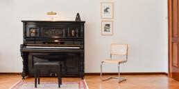 Herrenhaus im Maltatal - Ankommen - Klavier und Sessel
